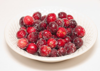 Sugared cranberries in white china with clipping path