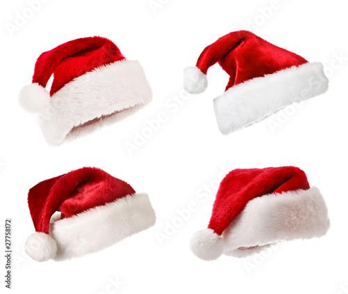 Leinwandbild Motiv Santa hats isolated on white