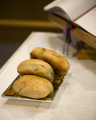 Communion Bread laid next to a Bible