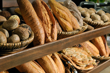 Assortment of baked bread on shelves.