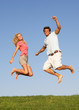 Young couple jumping in air
