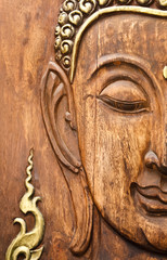 Buddha' face, carving from teak wood in Thai style