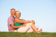 Senior couple posing in a field