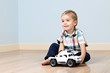 Cute boy with toy car