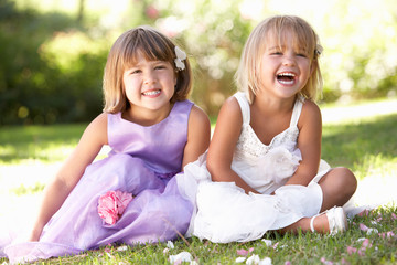 Two young girls posing in park
