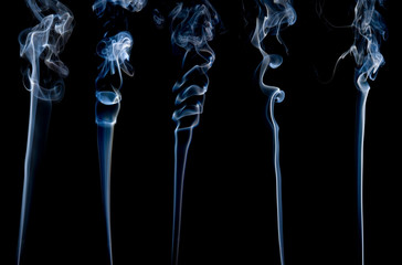 five different separate wisps of smoke on black;