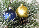 Two New Year's spheres on fur-tree branches