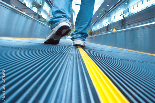 Foot move in airport escalator