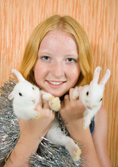 girl with two pet rabbits