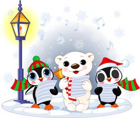 Christmas carolers –  polar bear and two penguins