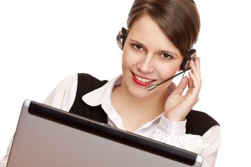 Telefonistin mit headset telefoniert freundlich mit Kunden