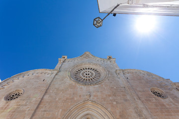 church, sun and blue sky in Italy