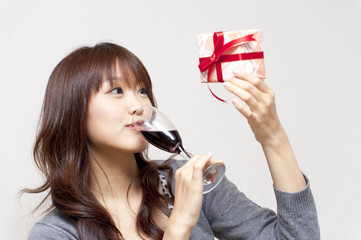 a portrait of beautiful woman taking a red wine