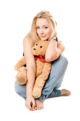 Smiling blonde with a teddy bear