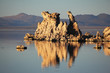 Tufa stalactites are reflected in smooth water