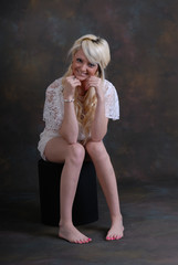 Pretty blond girl in white lace