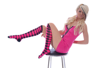 Sexy young woman posing on stool