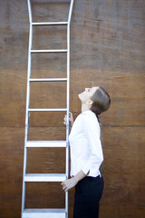 Woman climbing career ladders