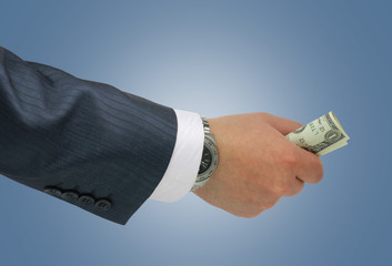 Hand of businessman holding dollar