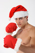 Sexy muscular man boxer wearing a Santa Claus hat