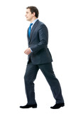 Full body portrait of walking businessman, isolated on white