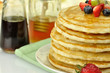pancakes with maple syrup,honey and berries close up