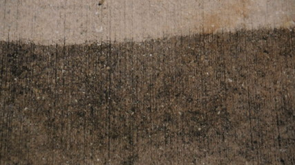 Pressure cleaning a dirty old driveway - close-up