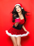 Beautiful and sexy woman wearing santa clause costume