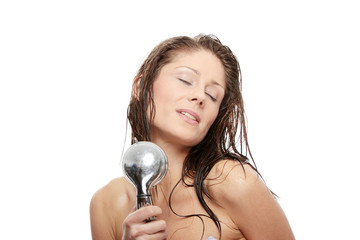 Young woman singing under shower