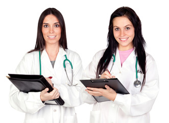 Two doctor women doing report