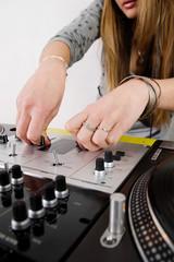 Female DJ adjusting sound level