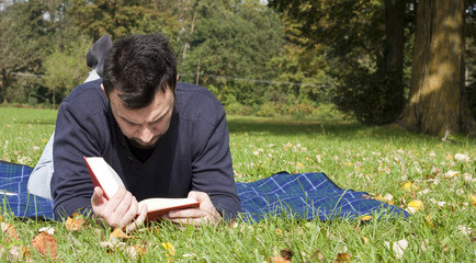 Young Adult Reading at the Park