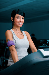 Exercising with treadmill at gym