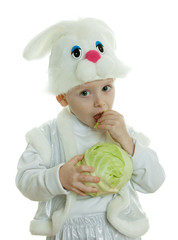 The boy in a suit of a rabbit holds cabbage