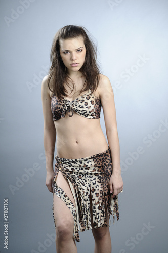 Poster white female playing caveman character