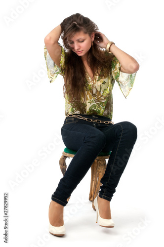 attractive girl sitting on the chair