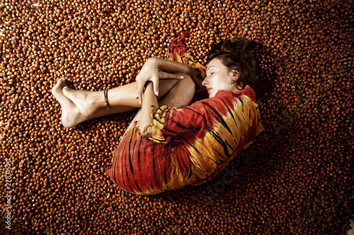girl sleeping on a hazelnuts