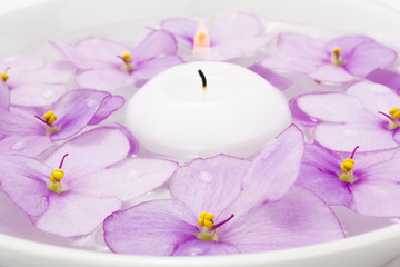 Floating candle and lilac flower