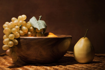 Still-life with fruit in a wooden dish
