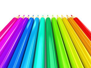 Colour pencils over white background