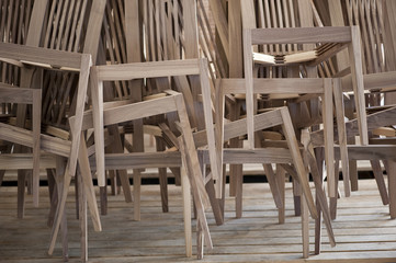 Unifinished Wooden Chairs Piled Up