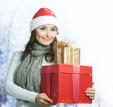 Beautiful Santa Girl with Christmas Holidays Gifts