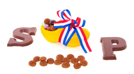 gingernuts and chocolate alphabet letters in decorated clog for