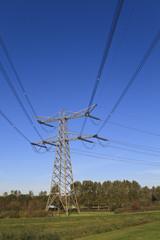 Electricity pylon aginst a blue sky