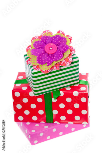 red and pink gifts decorated with a fabric cotton flower isolate