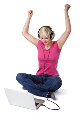 Happy woman with notebook and headphone