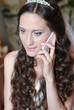 Beautiful bride with telephone.