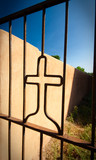 Angles Cross Shape Iron Gate Adobe Wall Blue Sky Vignette poster