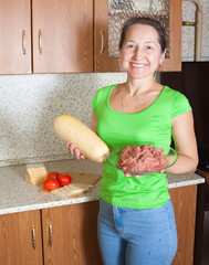 woman with ingredients for stuffed vegetable marrow