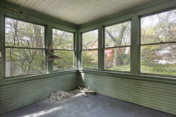 Green porch in old abandoned home